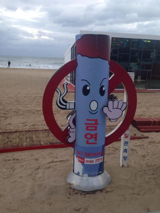 "A giant ""no smoking"" statue at the beach."