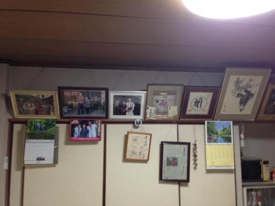 Pictures aligning the walls of Azumaya Ryokan